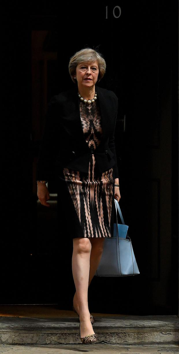 Theresa May leaves after attending a cabinet meeting at 10 Downing Street