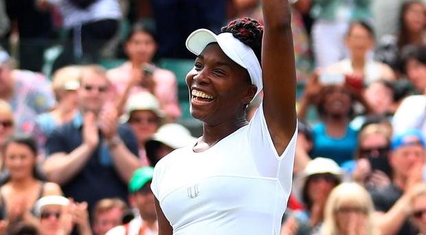 Hands up if you're in the semi-finals: Venus Williams celebrates her win over Kazak Yaroslava Shvedova