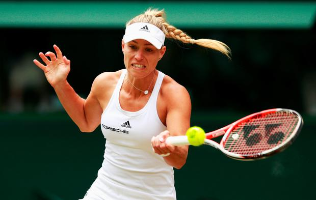 Hot form: Angelique Kerber on her way to beating Simona Halep to reach the Wimbledon semi-finals, having not yet dropped a set in this year's competition