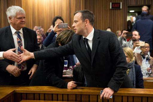 Oscar Pistorius has been sentenced to six years in jail for murdering girlfriend Reeva Steenkamp in his home on Valentine's Day 2013. (Marco Langori/Pool Photo via AP)