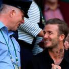 David Beckham in the stands on centre court on day nine of the Wimbledon Championships at the All England Lawn Tennis and Croquet Club, Wimbledon.