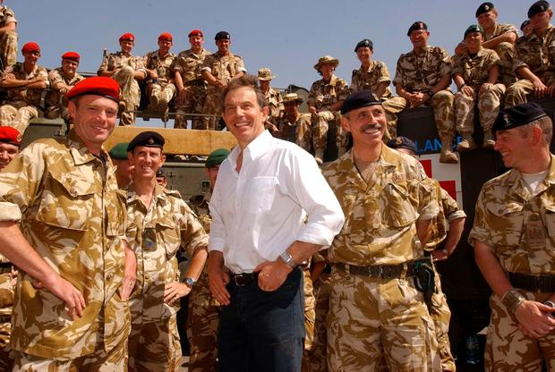 File photo dated 29/05/03 of former Prime Minister Tony Blair meeting troops in the port of Umm Qasr, Iraq. PA