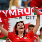 A Wales supporter waits for the start of the Euro 2016 semi-final football match between Portugal and Wales at the Parc Olympique Lyonnais stadium in Décines-Charpies, near Lyon, on July 6, 2016. / AFP PHOTO / MIGUEL MEDINAMIGUEL MEDINA/AFP/Getty Images