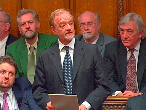 File photo dated 17/03/03 of Jeremy Corbyn (back left) listening as Robin Cook (centre) made his resignation speech in the House of Commons. Corbyn has condemned the decision to go to war in Iraq in 2003 as an
