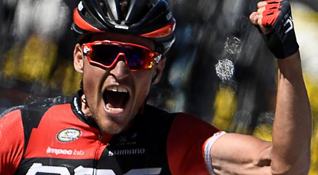 Others in shade: Greg van Avermaet celebrates yesterday's stage win