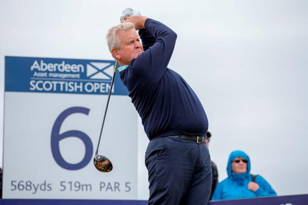 Ready for action: Colin Montgomerie gets into the swing of things ahead of the Scottish Open at Castle Stuart