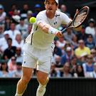 Big hit: Andy Murray fought off a Jo-Wilfried Tsonga comeback to progress