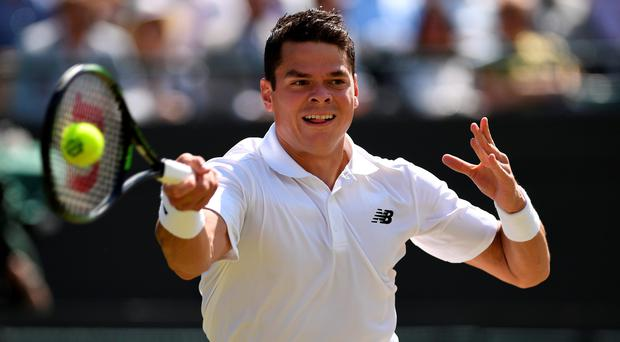 On the rise: Milos Raonic says John McEnroe has improved his game since joining his coaching team in the build-up to Wimbledon