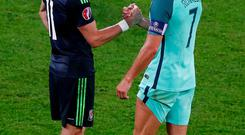 Star quality: Wales' Gareth Bale and Portugal's Cristiano Ronaldo at the end of last night's game in Lyon