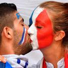 France supporters kiss prior to the Euro 2016 semi-final football match between Germany and France at the Stade Velodrome in Marseille on July 7, 2016. / AFP PHOTO / BERTRAND LANGLOISBERTRAND LANGLOIS/AFP/Getty Images