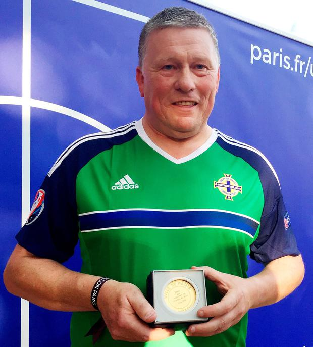 Jim Spratt from Belfast after accepting the Medal of the City of Paris on behalf of Northern Irish fans for their sportsmanship during Euro2016. PA