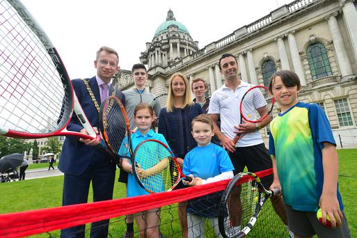 Smash hit: Lord Mayor Alderman Brian Kingston, Ulster Tennis Development Manager Lauren Smythe and members of Windsor Lawn Tennis Academy and David Lloyd Tennis Academy get ready for the Belfast City International Tennis Federation (ITF) Junior Tournament