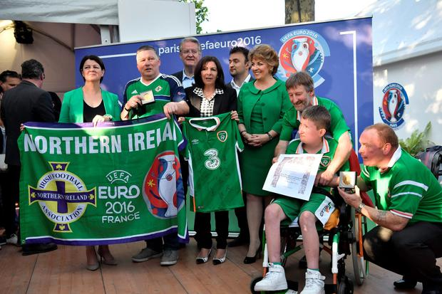 Paris mayor Anne Hidalgo (centre), with Irish Ambassador Geraldine Byrne Nason, presents the medals to Northern Ireland supporter Jim Spratt and Republic counterparts