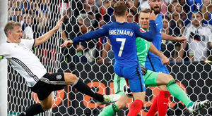 Done and dusted: Antoine Griezmann pokes home his and France's second to see off the challenge of Germany and earn a place in the Euro 2016 final