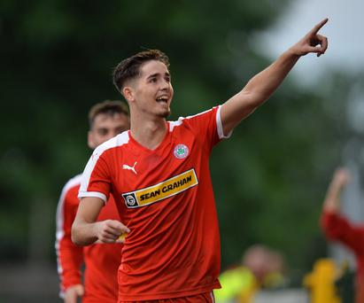 Pointing the way: Jay Donnelly celebrates scoring Cliftonville's second goal