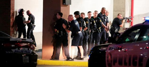 Dallas Police respond after shots were fired during a protest of fatal police shootings earlier this week in Louisiana and Minnesota, Thursday, July 7, 2016, in Dallas. (Maria R. Olivas/The Dallas Morning News via AP)