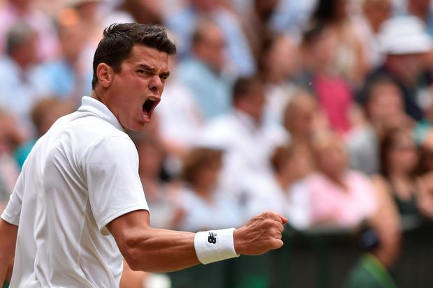 Canada's Milos Raonic celebrates winning the fourth set against Switzerland's Roger Federer. AFP/Getty Images