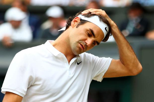 TSwitzerland's Roger Federer reacts after losing a point to Canada's Milos Raonic. AFP/Getty Images