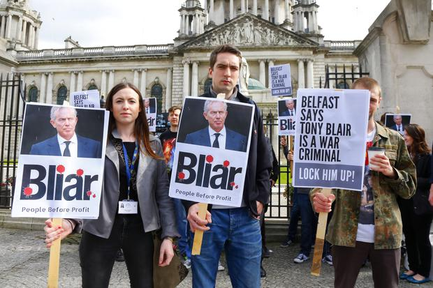 Credit - Kevin Scott / Belfast Telegraph Belfast, UK - July 08 , Fiona Ferguson and Matt Colins at A protest against Tony Blair held outside Belfast City Hall on July 08, 2016 ( Photo by Kevin Scott / Belfast Telegraph)