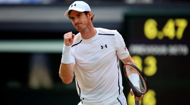 Andy Murray celebrates against Tomas Berdych on day eleven of the Wimbledon Championships at the All England Lawn Tennis and Croquet Club, Wimbledon. PA