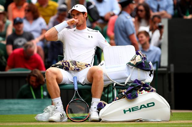 Scotland's Andy Murray looks on during the Men's Singles Semi Final match against Tomas Berdych of The Czech Republic on day eleven of the Wimbledon Lawn Tennis Championships at the All England Lawn Tennis and Croquet Club on July 8, 2016 in London, England. (Photo by Clive Brunskill/Getty Images)