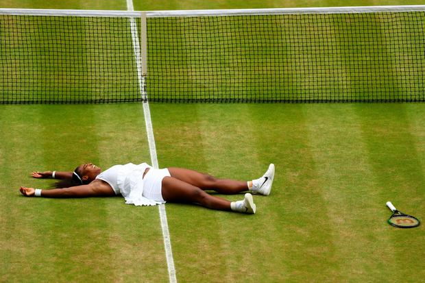 Serena Williams of The United States celebrates victory following The Ladies Singles Final against Angelique Kerber of Germany on day twelve of the Wimbledon Lawn Tennis Championships at the All England Lawn Tennis and Croquet Club on July 9, 2016 in London, England. (Photo by Julian Finney/Getty Images)