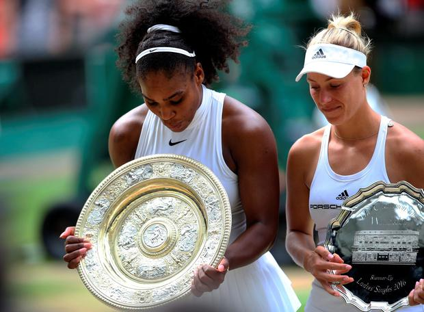 Serena Williams (left) and Angelique Kerber with their trophies after the Ladies singles final on day twelve of the Wimbledon Championships at the All England Lawn Tennis and Croquet Club, Wimbledon. PA