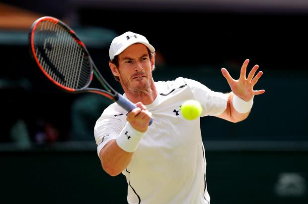 Andy Murray in action against Milos Raonic on day thirteen of the Wimbledon Championships at the All England Lawn Tennis and Croquet Club, Wimbledon. PRESS ASSOCIATION Photo.