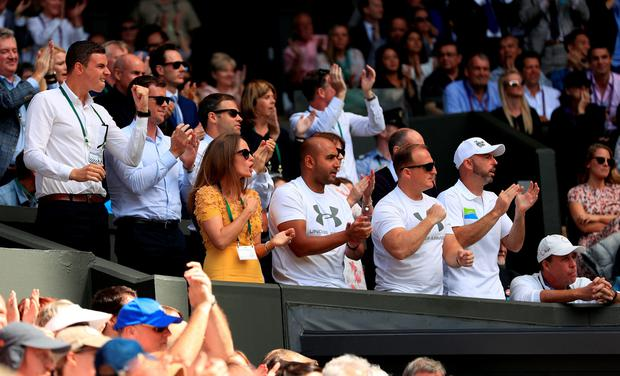 Kim Murray and Andy's coaching staff urge him on during the Men's Singles Final on day thirteen of the Wimbledon Championships at the All England Lawn Tennis and Croquet Club, Wimbledon. PRESS ASSOCIATION Photo. Picture date: Sunday July 10, 2016. See PA story TENNIS Wimbledon. Photo credit should read: Adam Davy/PA Wire. RESTRICTIONS: Editorial use only. No commercial use without prior written consent of the AELTC. Still image use only - no moving images to emulate broadcast. No superimposing or removal of sponsor/ad logos. Call +44 (0)1158 447447 for further information.