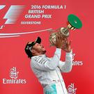 No catching Lewis: Nico Rosberg applauds as Lewis Hamilton celebrates his British Grand Prix victory