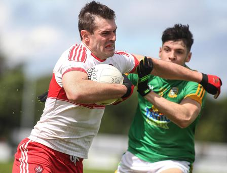 Lynchpin: Derry ace Mark Lynch holds off Meath's Seamus Lavin in his side's comeback triumph