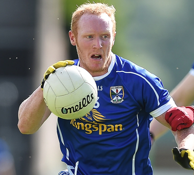 Attack: Cavan's Cian Mackey goes on the charge against Carlow