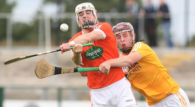 Closed down: Armagh's Declan Coulter is challenged by Eoghan Campbell