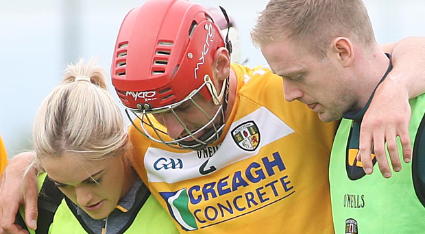 Blow: Antrim's Simon McCrory leaves the field with an injury