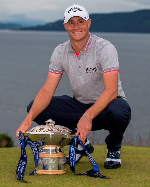 Swede success: Sweden's Alex Noren lifts the Scottish Open prize after beating England's Tyrrell Hatton by one stroke at Castle Stuart
