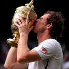 Victorious: Andy Murray lifts his second Wimbledon trophy