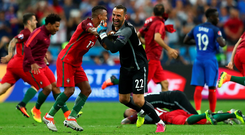 Striking gold: Portugal's players react with delight as the final whistle confirms their crown as champions of Europe