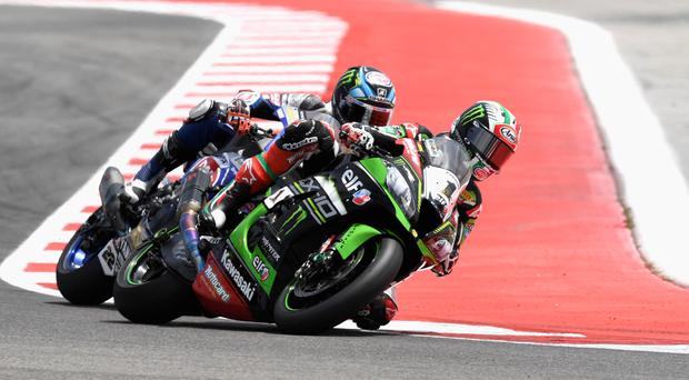 Mixed emotions: Jonathan Rea held off Tom Sykes to win race one in the Laguna Seca round of the World Superbike Championship but then failed to finish his second race