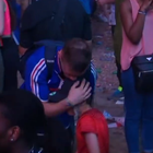 The moment a young Portugal fan comforts a France fan.