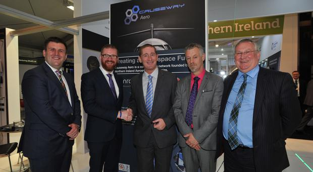 Economy Minister Simon Hamilton (second left) met representatives of the Northern Ireland aerospace companies in Causeway Aero