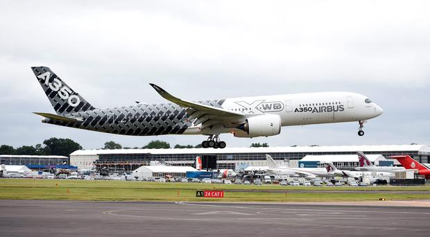 A new Airbus A350 carrying Sir Richard Branson lands at the Farnborough International Airshow in Hampshire