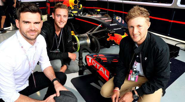 In the driving seat: Stuart Broad (centre) and England team-mates James Anderson (left), and Joe Root visit the Red Bull Racing garage before the British Grand Prix at Silverstone