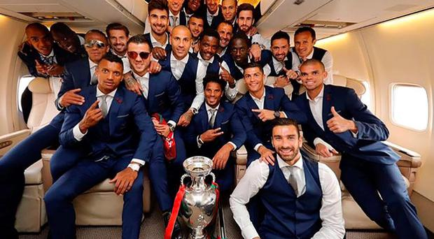 Flying high: Portugal players prepare to travel home with the Euro 2016 trophy