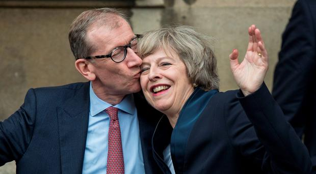 Theresa May receives a congratulatory kiss from her husband Philip John May after being confirmed as the new Tory leader yesterday