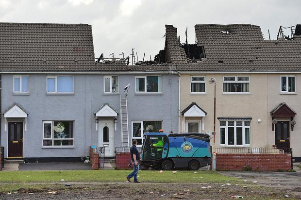 Shankill bonfire: Belfast terraced houses gutted in fire. Picture By: Arthur Allison /Pacemaker.