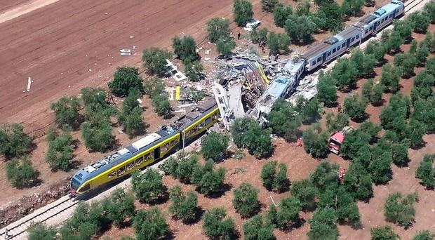This handout picture released by the Italian firefighters Vigili del Fuoco press office smashed carriages thrown across the tracks in the incident, which happened on a single track stretch of line between Ruvo and Corato, in the southern Italian region of Puglia. / AFP PHOTO / Vigili del Fuoco / --/AFP/Getty Images