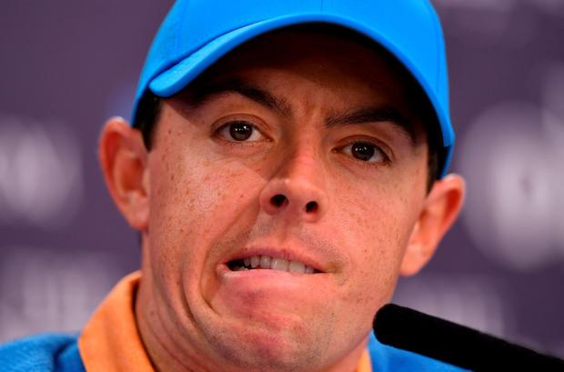 Northern Ireland's Rory McIlroy gestures as he speaks to members of the media at a press conference on July 12, 2016, ahead of the 2016 British Open Golf Championship at Royal Troon in Scotland. AFP/Getty Images