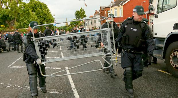 Officers remove barriers as The contentious orange order parade gathers at the stopping point on the Woodvale road during July 12th celebrations in Belfast , 2016 ( Photo by Kevin Scott / Presseye)
