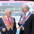 Left to right. Ivan Smith from Bedford lodge in England along with Brian Humphries from Upper Broomhedge LOL 799 enjoy some ice-cream in Wallace Park before the parade starts. Picture by Jonathan Porter/PressEye