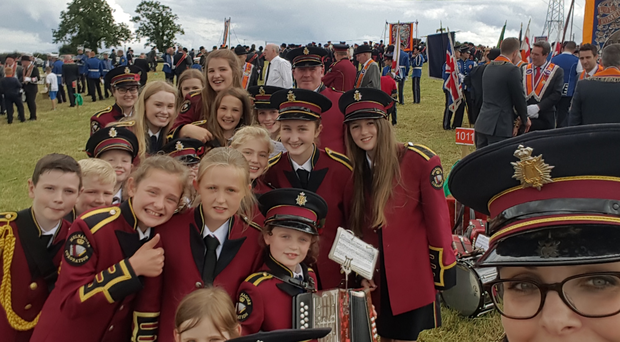 Louise Bradley and Mulnagore Coronation Accordion Band members in the demonstration field in Coagh.